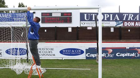 Daggers goal nets being taken down by assistant groundsman Dave Rose.