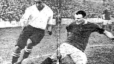 Walter Tull during his debut for Spurs in a match against Manchester United