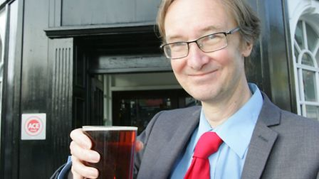 Cllr Cameron Geddes, who authored the report, celebrates the new steps it takes to safeguard pubs