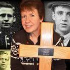 Kim Smith (centre) holding the cross she will erect. Her three great-uncles (Clockwise from top left