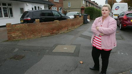 Angie Davies on the junction where the driver crashed into her garden fence