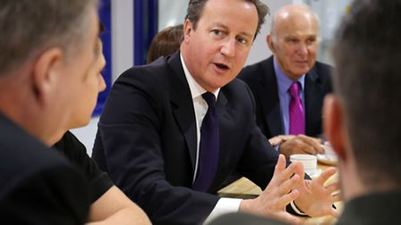 Prime Minister David Cameron talks to apprentices at Ford plant with Vince Cable Photo: Chris Radbur