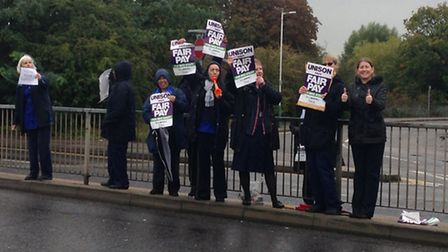 Placards were raised during the four hour strike (Photo: Ashleigh Coules)