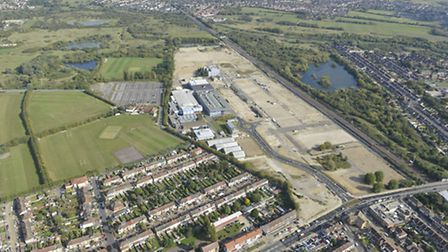 An aerial photo of the Sanofi site. The buildings to the left of the site by the new road and headin