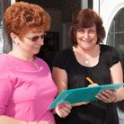 Pam Fletcher and Maria Brown signing a Labour party petition asking for spitting and urinating in th