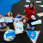 Artist Emma Scutt with year three pupils from William Bellamy Primary who are helping paint a mural