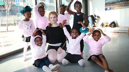 Young girls dance ballet in a showcase at Rivergate Centre.