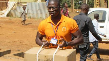 PJ during one of the deliveries of food and other vital supplies to an Ebola-affected household that