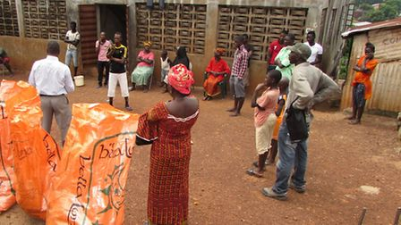 A delivery of food and essential items to an Ebola-affected household in quarantine