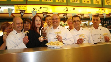 Jason Aiken (centre) with Kate Cox from the Potato Council and staff at the Golden Fish