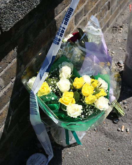 Tragic: Flowers and police tape outside the Beaver Centre the day after the stabbing