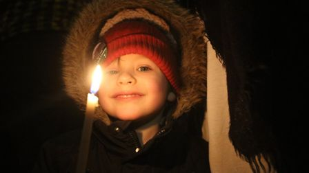 Lewis Clark, four, at a candlelit vigil outside the Civic Centre in Dagenham to make a stand as part