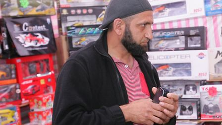 Market trader Rashid Suleman sells one of the dangerous dolls to Post reporter Anna Dubois