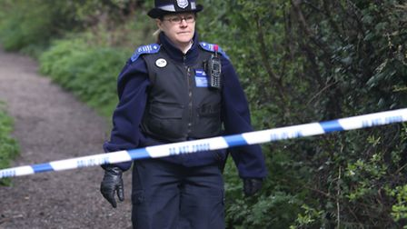 A police officer at Eastbrookend Country Park on The Chase in Rush Green, where Neill Buchel's body