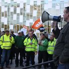 Binmen protesting outside Barking Town Hall against pay cuts