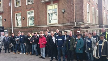 Members of the GMB Union protesting before the council meeting