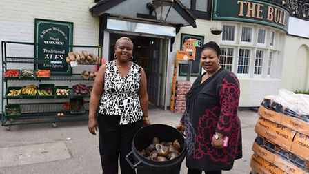 Owner Stella Osunbor with Margaret Akinwunmi outside their new supermarket, opened in what used to b