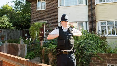 A police officer outside the house in Wykeham Green where a murder investigation was launched