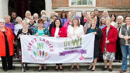 Members and supporters of the Women's Institute (WI) pose for a photo with the WI flag before the fl