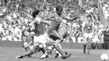 Chelsea's Paul Canoville (r) gets away from Arsenal's Brian Talbot (l) in the 80s