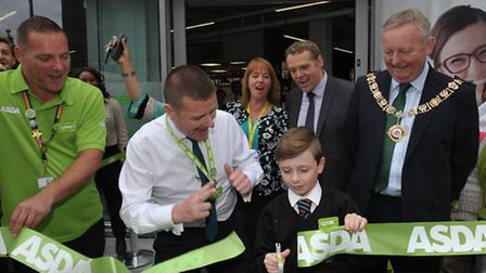 Harry Turner opens the store with manager Chris Good