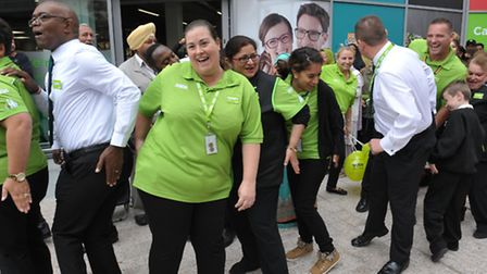 Asda staff do the pocket tap at the opening of the new store