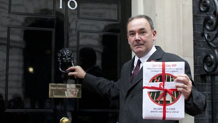 Jon Cruddas MP delivers a petition at Number 10 Downing Street, opposing prison plans last year