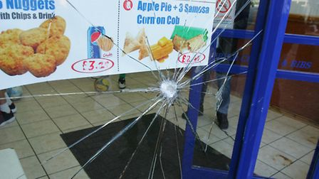 Smashed windows at next-door Chicks Chicken and Pizza