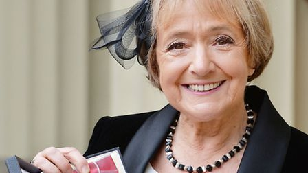 Dame Margaret Hodge holds her insignia of Dame of the British Empire which was presented by the Prin