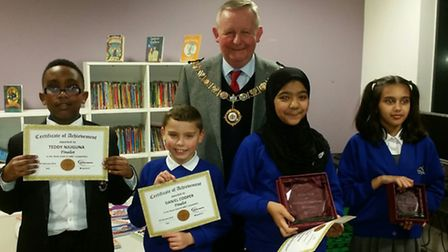 The Mayor, Cllr Simon Bremner, hands out prizes to the winner and runners up