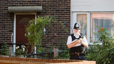 A police officer outside the Darbyshire property in Wykeham Green, Dagenham last year
