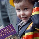 A signed copy of Harry Potter is held by Portobello Rugby Club mascot three-year-old Jack Henderson,