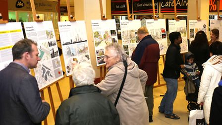 Members of the public view the plans at Vicarage Field shopping centre