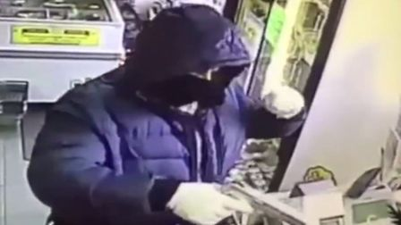 The man appears to be wearing the same clothes - and wielding the same gun - as a robber who struck