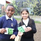 Excited pupils Clive Smith and Mukaroma Khanom planted rocket seeds as part of a nationwide project