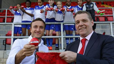 West Ham captain Mark Noble and Cllr Darren Rodwell with William Bellamy Primary's girls football si