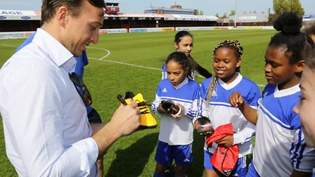 The Hammers' skipper autographs the players' boots