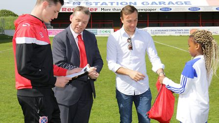 Daggers' Dom Hyam, Cllr Darren Rodwell and West Ham captain Mark Noble make the draw, assisted by Wi