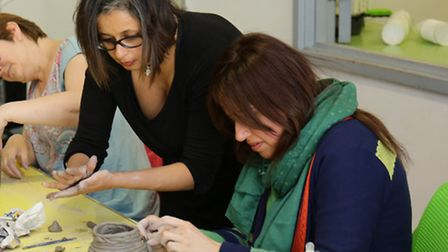 Residents take part in the coil pottery class