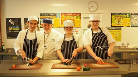 Lynden Davies Lecturer and NACC Care Cook of the Year 2016 judge with students (l-r) George Fodor, L