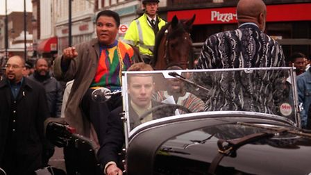Muhammad Ali riding through Brixton when he visited in 1999 (Pic: Matthew Fearn/PA)