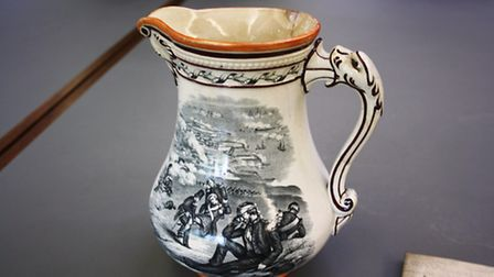 A jug from the exhibition at Valence House that shows soldiers injured on the battlefield during the