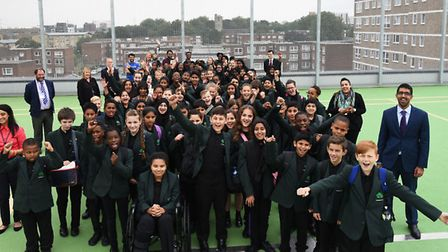 Greatfields School pupils and teaching staff on the roof of the Gascoigne Primary School Annex