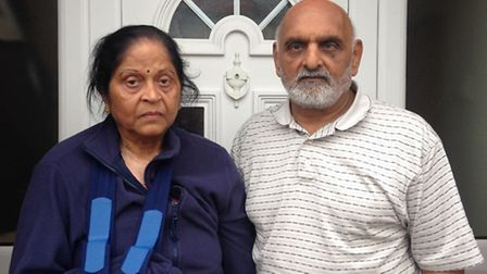 Hasumati and Arvind Patel outside their home in Cecil Avenue, Barking, after the burglary.