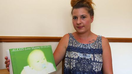 Chloe Turner with a canvas of her daughter Alexis