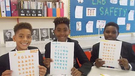 Students learn the Bengali alphabet