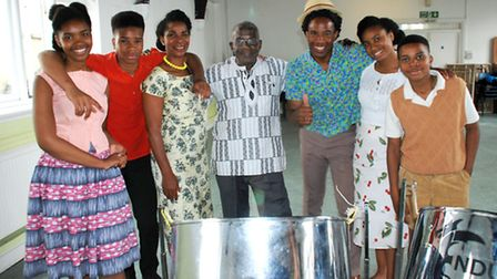 The Irwin family with actor Rudolph Walker, centre, will feature in the documentary later this month