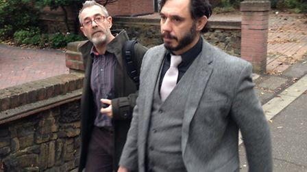 David Michael Bell, right, walks free with his boyfriend after receiving a suspended sentence for ho