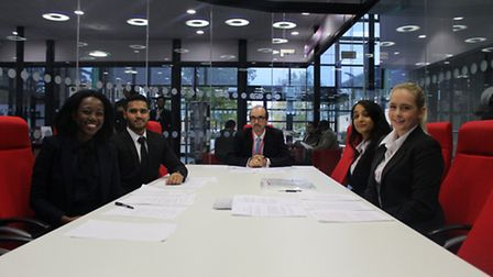 Barrister and mentor Simon Cheetham with Barking and Dagenham College law students