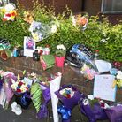 Flowers left near the junction where Sean Thake died
